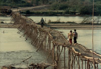 Bambbo bridge crossing Mekong river in Thailand near Loas